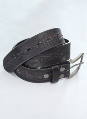 The western-inspired black leather belt is embossed with weathered linework and an antique pewter buckle.