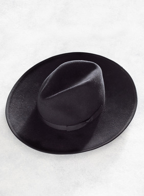 Made in the USA, this black wool felt hat is trimmed with grosgrain ribbon around the brim. Effortless and chic.