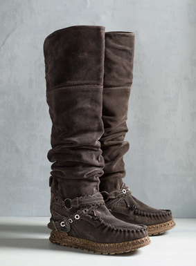 "Crafted in Tuscany, the tall, scrunchable moccasin boots in Peat suede have ankle straps, scalloped eyelets, metal hardware and rubber soles. 21"" shaft; hidden 2½"" wedge heel. <a href=""/category/womens+seasonal+trends/el+vaquero.do"" target=""_blank"">Read more about El Vaquero footwear and why their craftsmanship is unmatched.</a>"