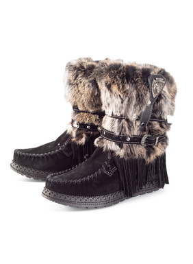 "Handcrafted in Tuscany, our fur-trimmed moccasin boots are supple suede with a plush shearling lining. Styled with buckling leather straps, suede fringe and a hidden, cushioned, 2"" wedge. <a href=""/category/seasonal+trends/el+vaquero.do"" target=""_blank"">Read more about El Vaquero footwear and why their craftsmanship is unmatched.</a>"