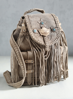 A boho-luxe accent, the suede backpack is handcrafted in the foothills of Tuscany. The backpack features a flap closure, outer pockets, dramatic fringe, silver findings and turquoise-hued bead accents; adjustable shoulder straps.
