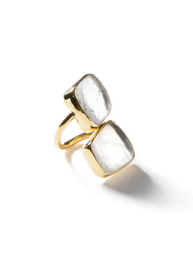 Two organic quartz stones are set in brass bezels on the statement cocktail ring.