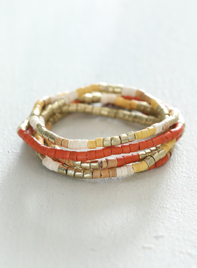 A mix of brass nuggets and shell heishi beads, the set of 5 stretchy bracelets shimmers in warm hues of citrus orange, creamy beige, and ivory.  The set can be mixed and matched with other bracelets, or looks great as its own stack.